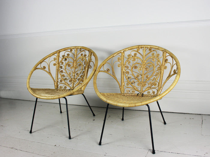 A pair of 1960's bucket rattan chairs with heart shaped design