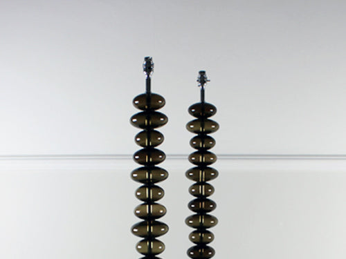 A pair of Italian chrome and grey glass ball floor lights