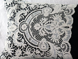 Ivory Edwardian lace on antique black linen bolster by Charlotte Casadéjus