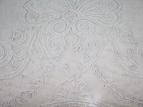 Antique embroidered tulle on linen bolster by Charlotte Casadéjus