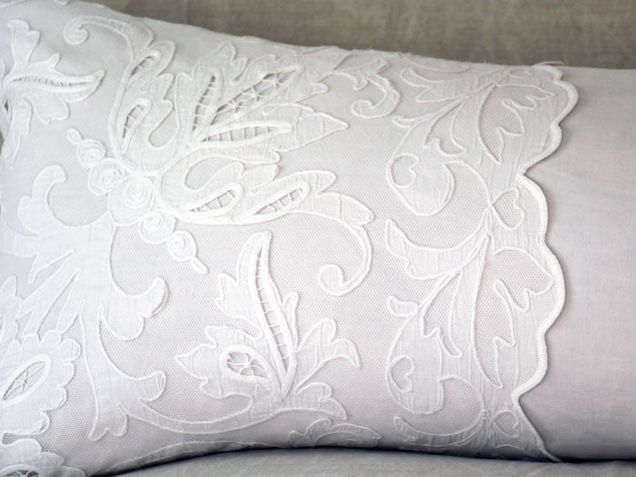 Antique embroidered scalopped tulle on linen bolster by Charlotte Casadéjus