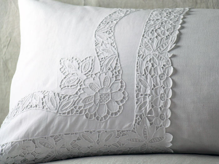 Antique embroidered thread work on linen bolster by Charlotte Casadéjus