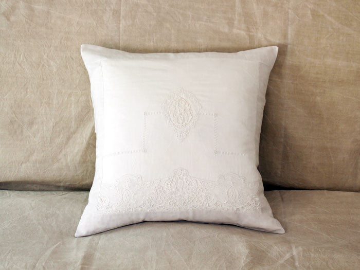 An antique French linen monogrammed 50cm square cushion - initials MS/SM