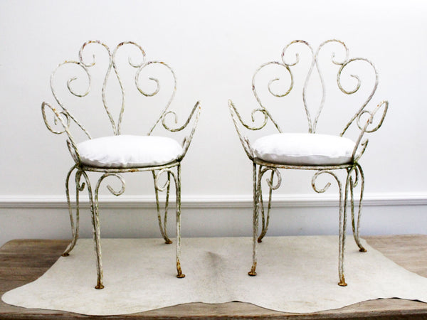 An Elegant French Pair of Painted White Wrought Iron Garden Chairs