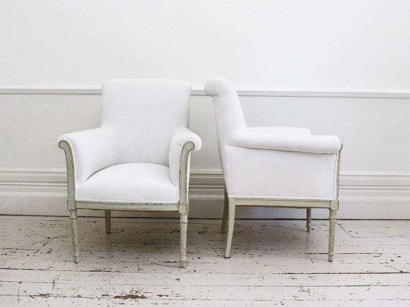 A Pair of Painted Scroll Back Antique French Armchairs