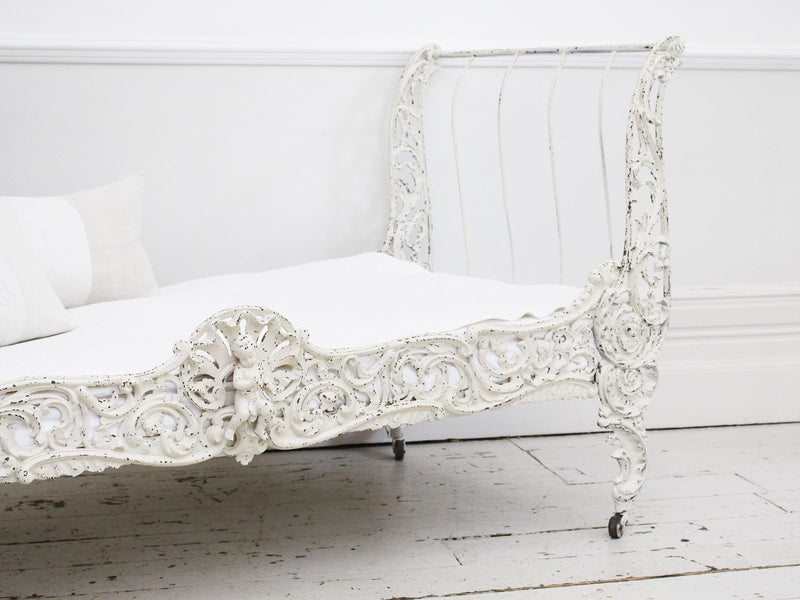 An Ornate 19th Century French Painted White Metal Daybed