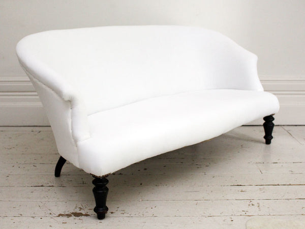 A Large Early French Sofa with Curved Back and Serpentine Front