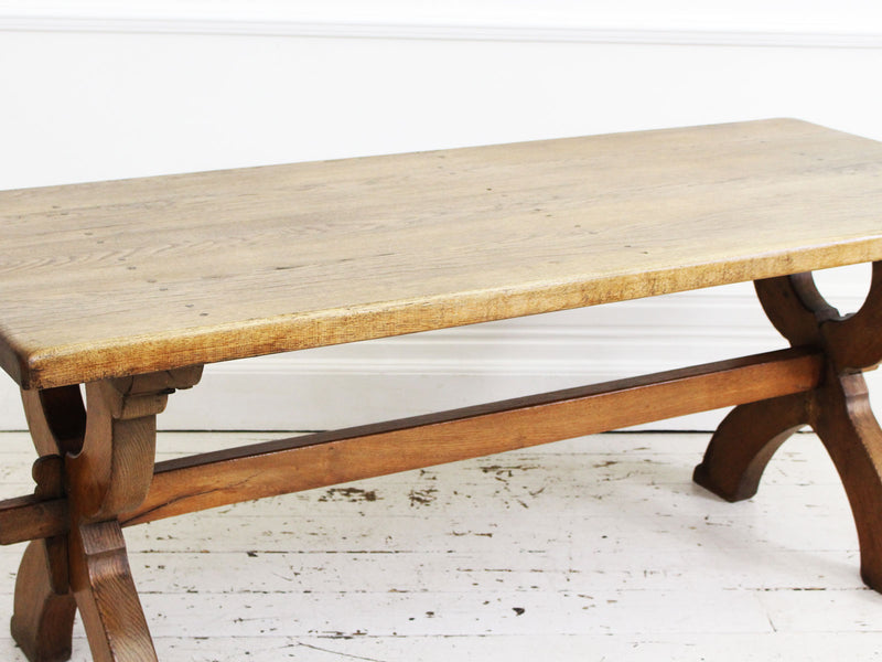 An Antique French Oak Cross Leg Sawbuck Trestle Dining Table