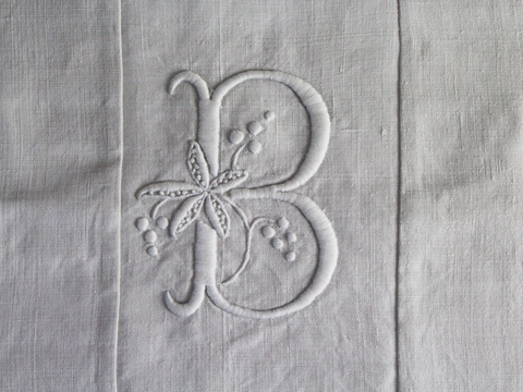 Antique monogram on linen bolster 'FD' by Charlotte Casadéjus