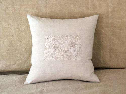 An antique French linen and lace 50cm square cushion