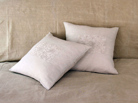 An antique French linen and guipure lace 50cm square cushion
