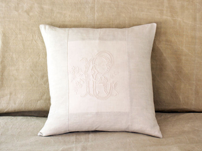 An antique French linen monogrammed 50cm square cushion - initials RC