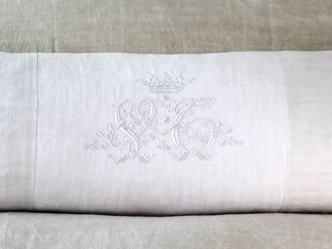 A rare antique monogram 'VC' with crown on linen bolster by Charlotte Casadéjus