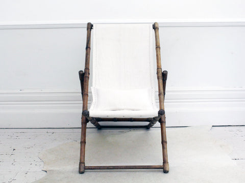 A Rare Regency Faux Bamboo Deck Chair with Linen Covering