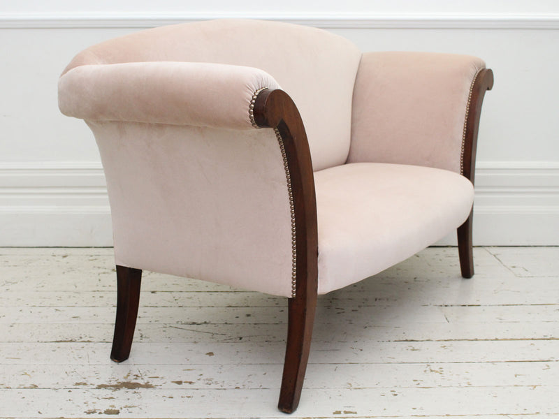 A Sabre Legged Regency Sofa Upholstered in Pale Blush Velvet