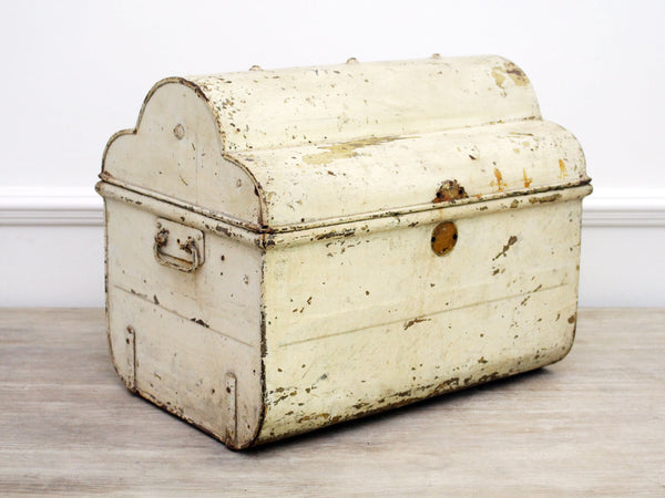 A Vintage Light Ivory Metal Trunk with Scalloped Top and Blue Interior