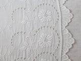 Antique French scalloped lace on linen bolster by Charlotte Casadéjus