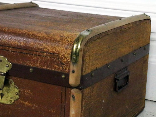 A Large brown canvas and wood trunk