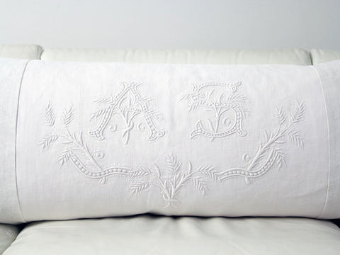 Antique monogram on linen bolster 'AS' by Charlotte Casadéjus