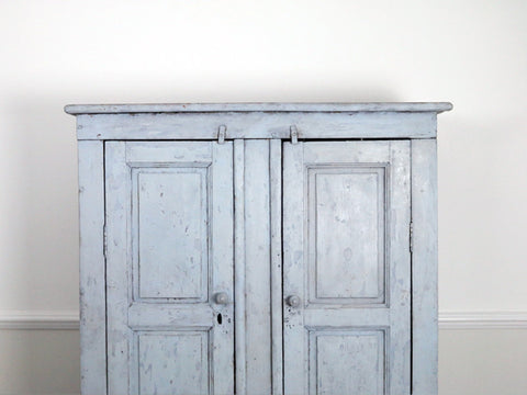An early 19th century French blue painted cupboard