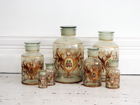 A set of 7 Early 20th C Hand Painted French Apothecary Jars