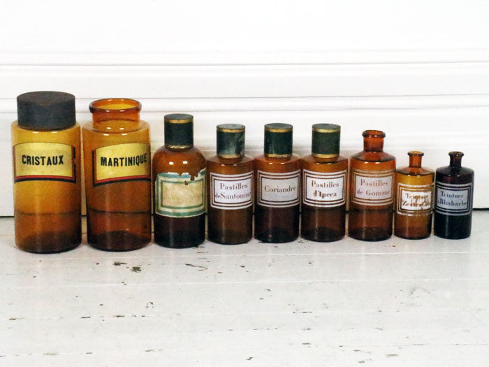 A set of French amber antique apothecary jars