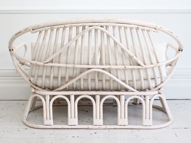A 1950's French White Bamboo Sofa with Antique Linen Cushions