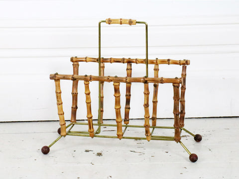 A 1960's bamboo and brass magazine rack