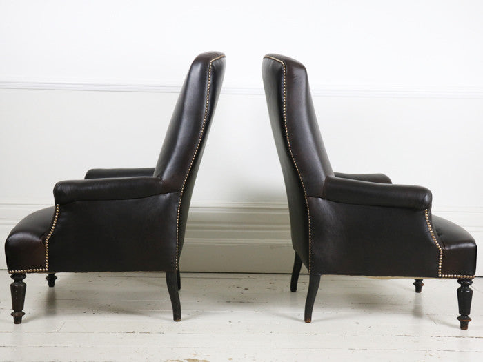 A pair of leather Napoleon III French library armchairs