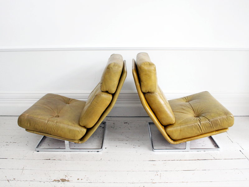 A Pair of large Tetrad 'Nucleus' Leather & Chrome Low Chairs