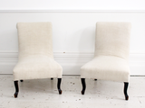 A pair of Napoleon III scroll back French chairs