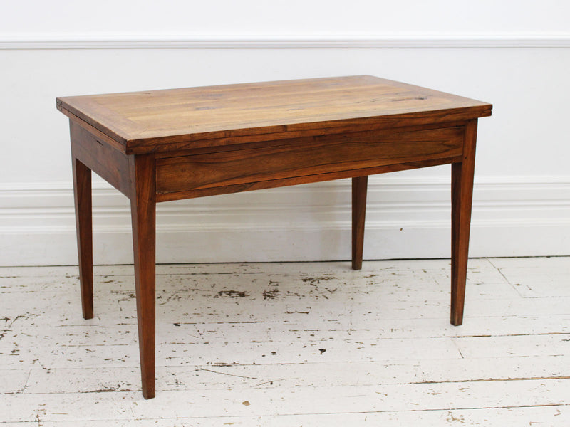 A 1970's French Portfeuille Walnut Dining Table