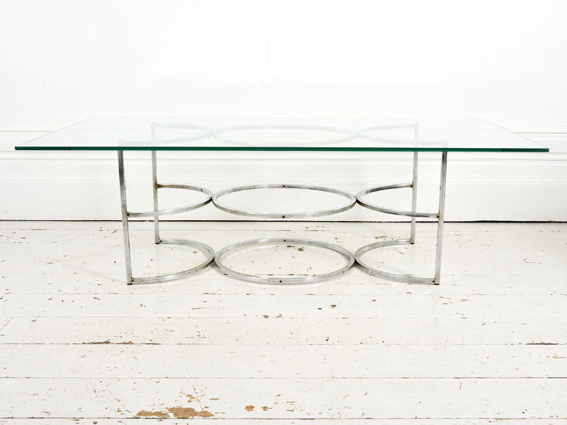 A 1960's Coffee Table with chrome circle base & glass top