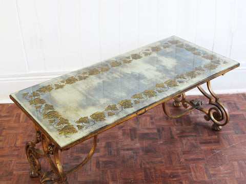 A 1930's Maison Baguès Eglomisé Coffee Table with Gilt Metal Base