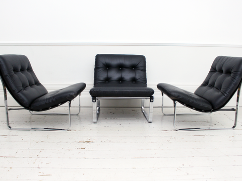 A Pair of 1940's Steiner Armchairs with Icelandic Sheepskin Upholstery & Brass Detailing