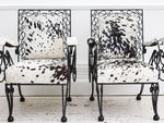 A Pair of 1950's French Cowhide Wrought Iron Armchairs