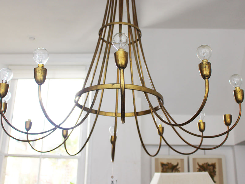 A Large Mid Century Italian Twelve Arm Brass Chandelier