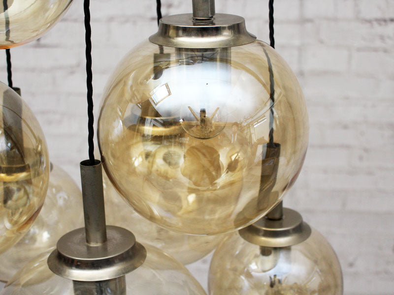 A 1970's French Pendant Light with Seven Pale Gold Glass Shades