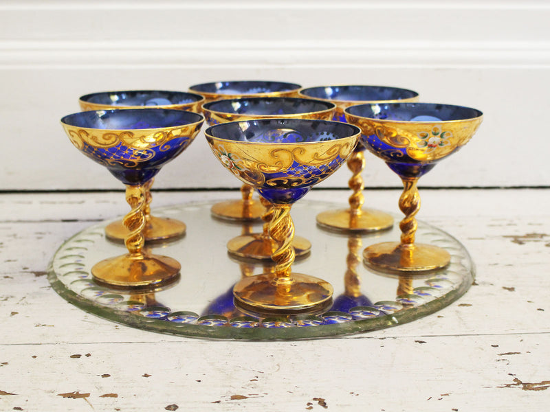 A Set of 7 Ornately Decorated Blue 1950's Murano Champagne Coupes