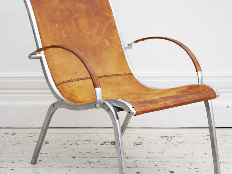 A 1970's Tan Leather & Aluminium Armchair in the manner of Rudolf Szedleczky
