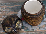 A French ceramic and leather owl cookie jar