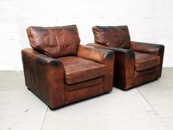 A Pair of Very Large Vintage Brown Leather Armchairs