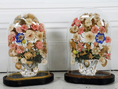 A Pair of early 20th C French Floral Glass Domes