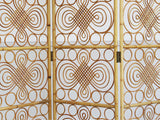 A 1960's ornate rattan room screen