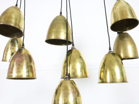A set of 9 early 20th C brass pendant lights