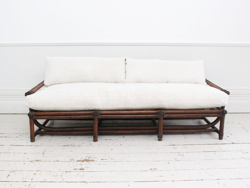 A 1950's French Bamboo Sofa and Pair of Armchairs