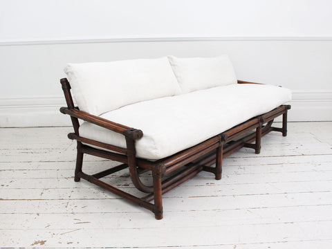 A 1950's French Bamboo Sofa with Antique Linen Cushions
