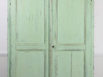 A 19th century French green painted cupboard