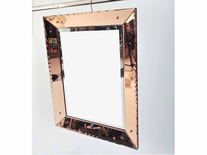 A 1970's French amber framed mirror