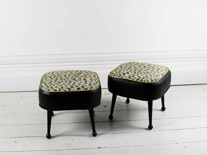 A pair of 1960's animal print black and gold footstools